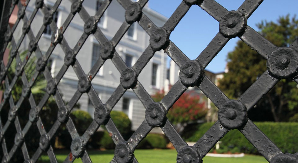 home fortified with iron fence