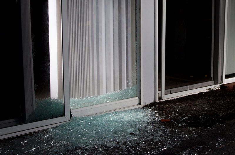 sliding glass door with broken glass
