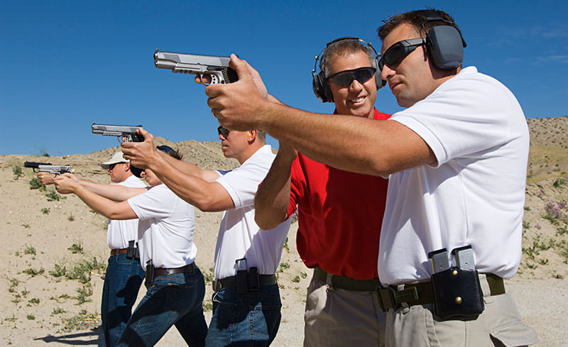 people at a firing range
