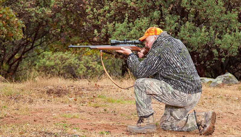 hunter taking a shot