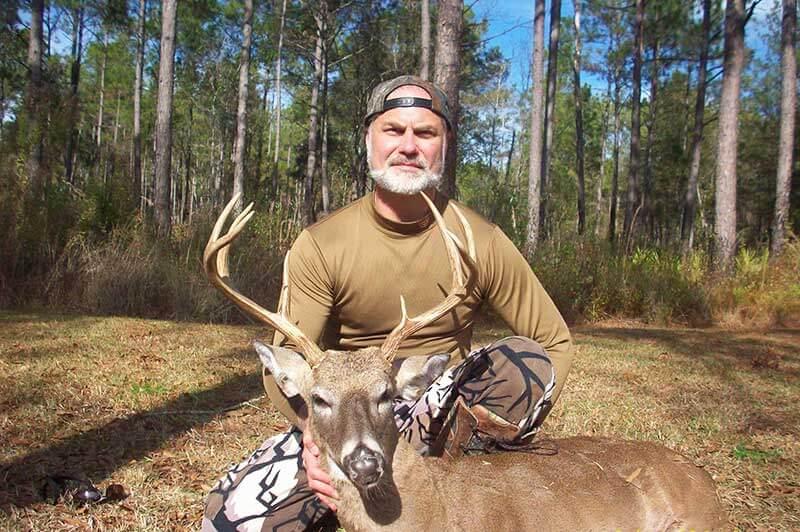 deer hunter with kill