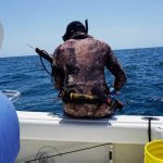 speargun fishing from boat